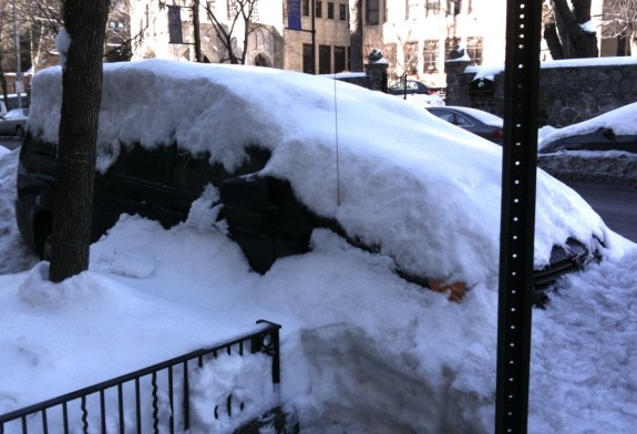 Minivan covered by snowbank in NYC