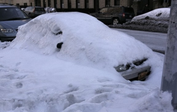 Car buried in snowbank in New York